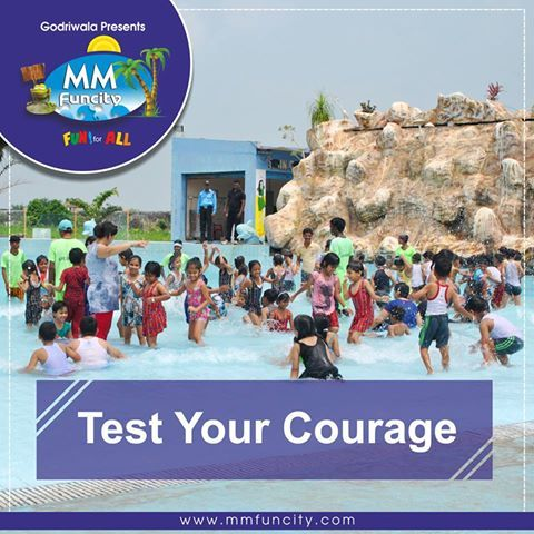 Life is either a daring adventure or nothing at all ~Helen Keller. Test your courage on our Giant #Slide at #MMFunCity. For More: https://goo.gl/Su9dWZ #WaterPark #WaterRides #Raipur #Family