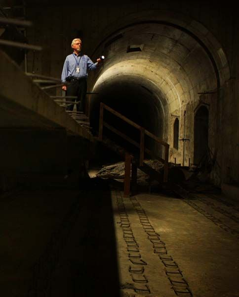 Chris Harding, of the Australian Railway Historical Society, in the labyrinth of old mail-dispatch tunnels beneath Central Station