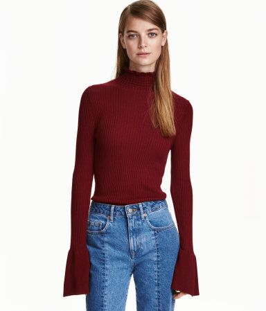 Burgundy. Rib-knit sweater in a viscose blend with ruffle-trimmed mock turtleneck and long sleeves with wide, flounced cuffs.