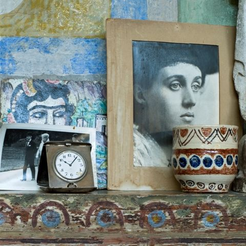 Charleston: the home of artists Vanessa Bell and Duncan Grant.  Studio mantelpiece detail with portrait of young Vanessa Bell.