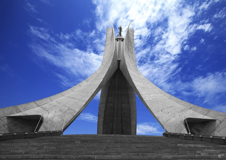 The Martyr's Shrine (Arabic: مقام الشهيد, Maqam E'chahid) is a war memorial overlooking the city of Algiers, which was erected in 1982 to mark the 20th anniversary of   national independence (July 5, 1962), in memory of the dead from the war of independence of the country.                                                                                                                                                                                 Plus