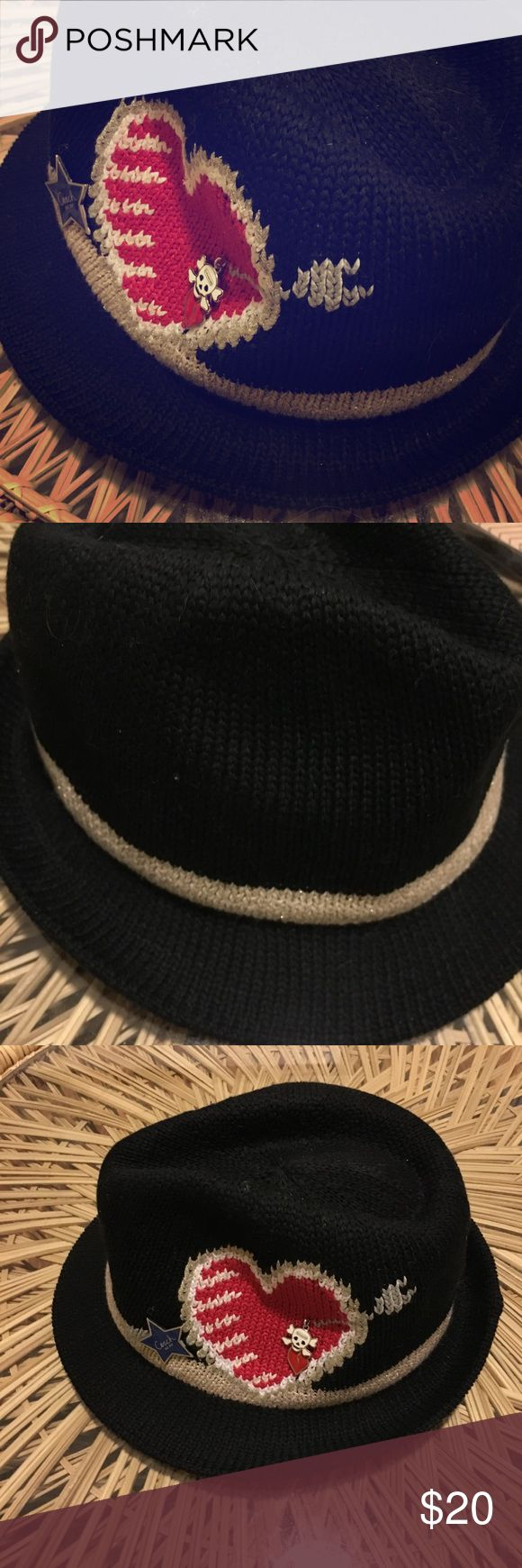 heartfelt COACH trilby hat Pun intended: This is a dark-as-night felt hat from Coach with a brilliant heart motif. Like new. Three charms: blue star (engraved with Coach logo), a skull and crossbones and puckered lips adorn the motif. Message me for more photos/angles of the hat. Coach Accessories Hats