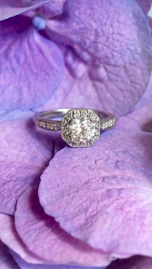 Diamond accents and milgrain detailing give this ring a truly vintage feel.