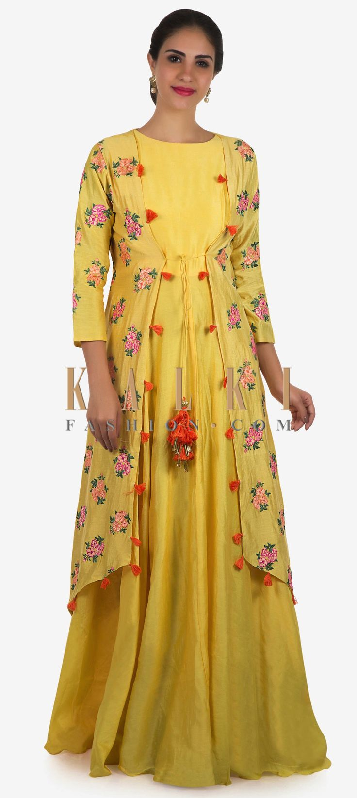 Buy Online from the link below. We ship worldwide Click Anywhere to Tag Yellow tunic in cotton with jacket beautified in resham butti work only on Kalki   Yellow tunic is featured in cotton fabric. The tunic is matched with a jacket that is featured in resham floral butti embroidery work with attached tassels at the corner. Slight variation in color is possible.