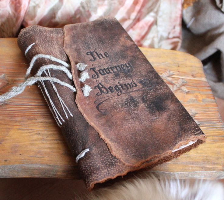 #DBBridalStyle Leather wedding guest book personalized with old font, brown craft paper Medieval look. $175.00, via Etsy.