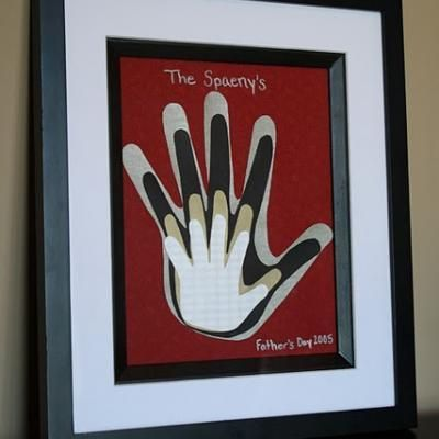 Framed Family Handprints {Crafts for Fathers Day} - Get the whole family in on the crafting action this Father's Day. Have each family member trace their hand on coordinating patterned paper and frame it for a keepsake Dad will love on Father's Day and all year long ...