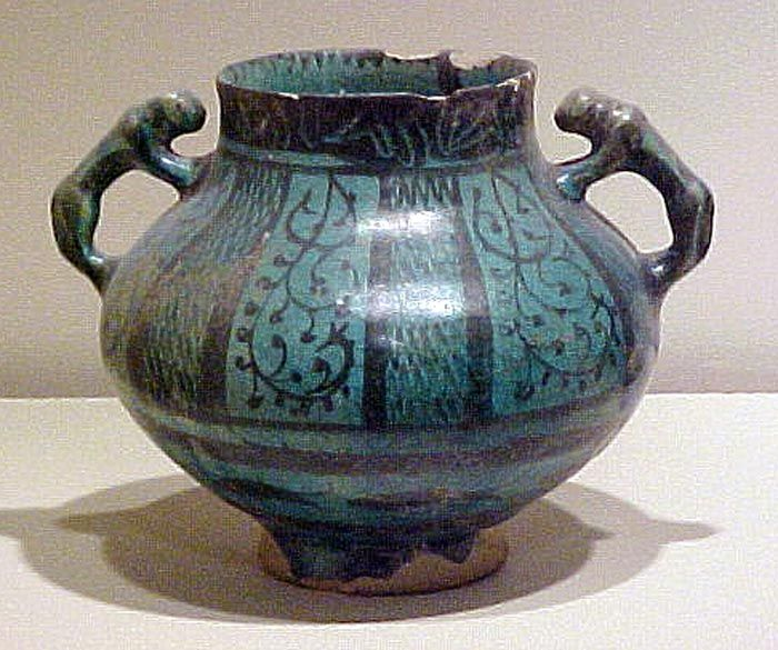 ^ Medieval Persian lion handddle jug in Blue/Black glaze. Probably from Rayy during the 12th or 13th century. Specimen in the collection of the Royal Ontario Museum in Toronto, Canada.