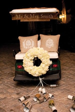 Getaway golf cart with floral wreath | photography by http://lauranegriphotography.com/