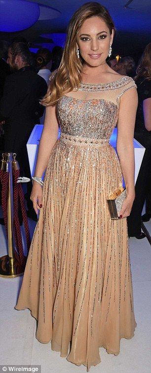 She's a real gem! the 35-year-old teamed her glittering dress with an array of jewels desi...