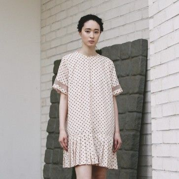 [Ipanema Dress: Beige] A #dress featuring a pleated #skirt and mesh details on sleeves. Round neckline. Short sleeves. Back button closure. #dotdress #dotteddress #polkadot #polkadotdress #meshdress #koreandress #asiandress #cutedress #fashiontoany