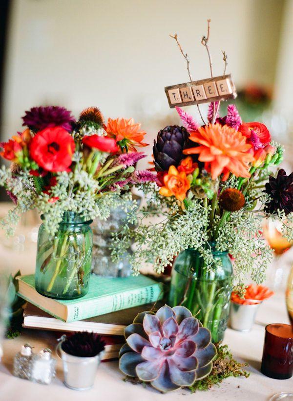 Mason Jars-dahlias, Ranunculus, queen anne's lace, succulents, artichokes and SCRABBLE table numbers! <3