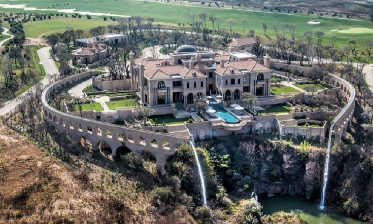 Palazzo Steyn, in Midrand, Gauteng, South Africa - 32,000 square feet neatly framed by the twin 'ruined' aquaducts carrying water that cascades into a man-made lake...