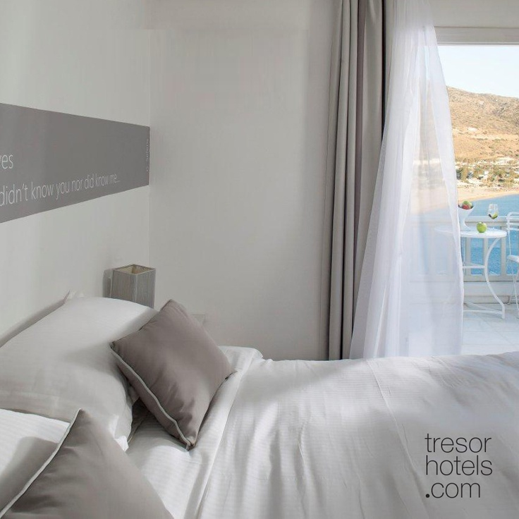 Trésor Hotels and Resorts_Luxury Boutique Hotels_#Greece_ Superior rooms are located at the highest level of the complex and have an easy access to the second largest swimming pool. Their decors and furniture preserve the aesthetics of #Cycladic architecture and are bound to fulfil your love for luxury and comfort.