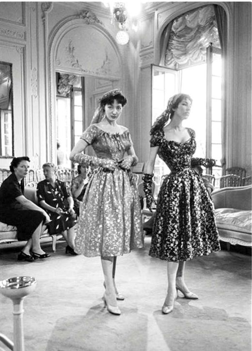1953 Two models (Victoire on right) in Dior's metallic dresses with matching gloves and scarves from his 'Vivante' haute couture line, Autumn/Winter 1953, photo by Mark Shaw, Maison Dior.