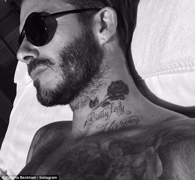 'Happy Friday!': Just after the former Spice Girl posted it, she also shared a snap of husband David, 40, sunbathing shirtless, his new neck tattoo on display