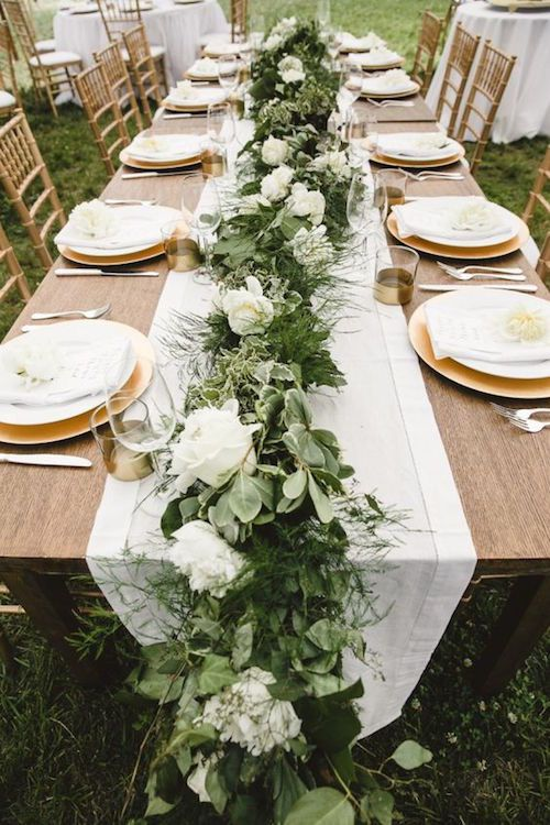 French-themed New England wedding in white gold and filled with greenery.