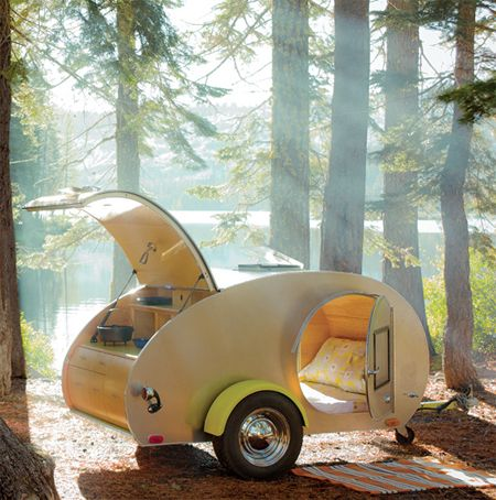 """This is the modern version of the """"TearDrop Trailer"""" we had when I was a kid .. one night the parents had the trailer and the kids had the tent .. the next night we switched off.  The back had a well stocked kitchenette with a two-burner stove and a tiny sink that drained right onto the ground (or in a bucket)."""
