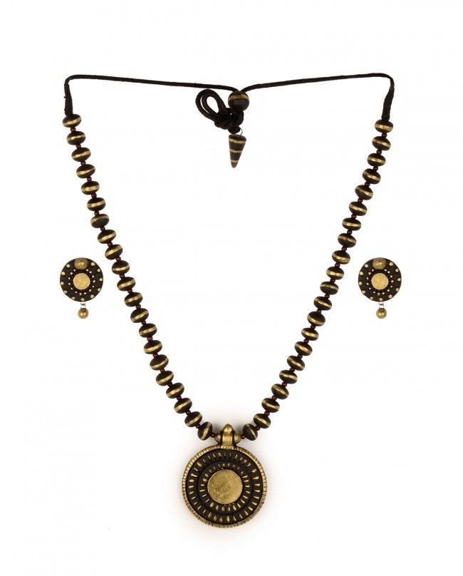 Golden and Black Beaded Necklace Set with Disc Pendant by Maatikaar Shop Now: http://bit.ly/maatikaarnew #Earthy #Terracotta #Jewelry #Maatikaar #India #Classy #Traditional #Indian #Designer #Earrings #Necklaces #Jewellery #Red #Brown #Black #Golden #ExclusivelyIn #Golden