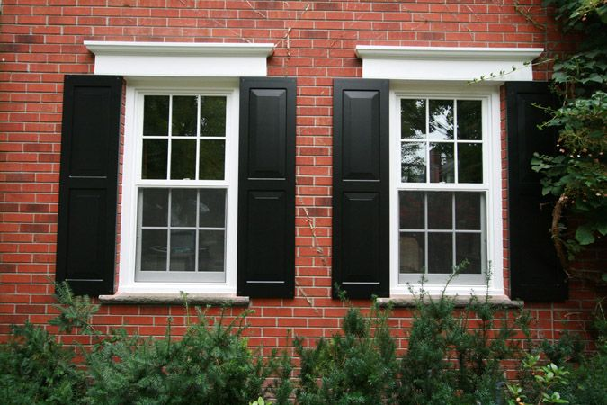 black shutters on red brick- white trim.........