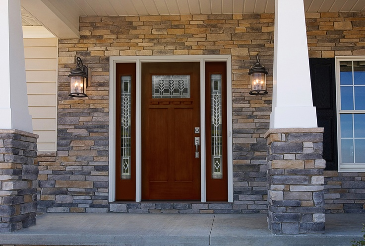 This distinctive southwestern-inspired entry door, along with ProVia stone veneer, will enhance any home's appearance.
