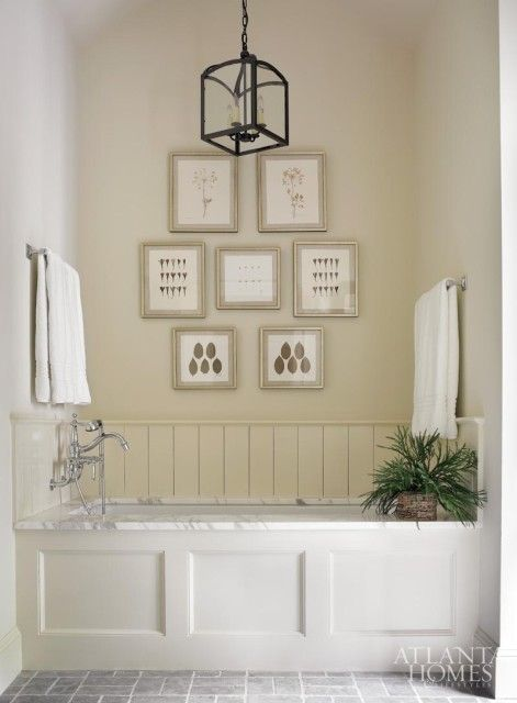 In the master bath framed botanicals from the atlanta Bathroom design centers atlanta