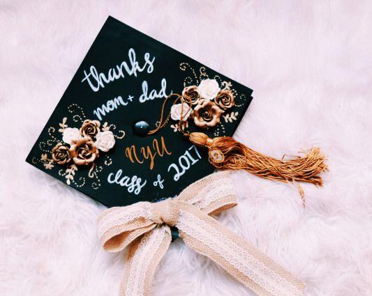 NYU decorated graduation cap gold and white flowers ribbon pretty grad cap. #highschoolgraduation #high #school #graduation