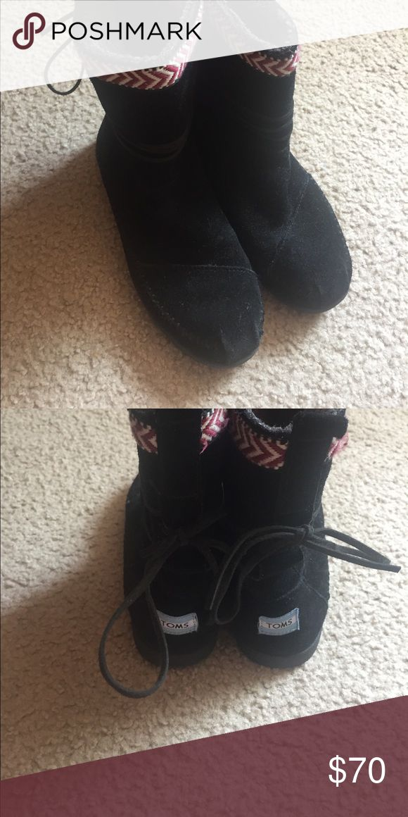 Warm toms boots 👢 Cute black boots with burgundy and white zig-zag trim and super cute ties that wrap around and make a bow in the back!!! Awesome condition! Toms Shoes Ankle Boots & Booties