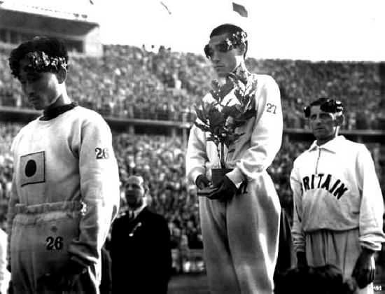 Gijeong Son a Korean marathon runner hides the Japanese flag on his chest with a sapling tree after achieving 1st place in the Berlin Olympics 1936. [550x420]
