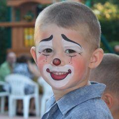 Adorable model for clown face paint