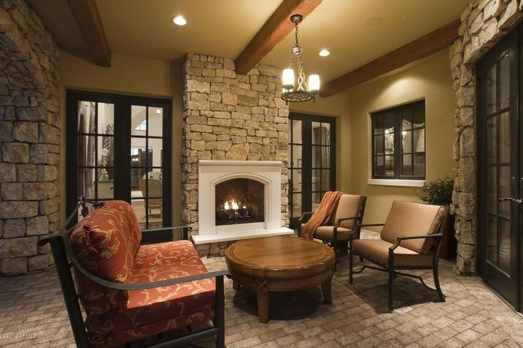 Craftsman Porch with exterior brick floors, outdoor pizza oven, French doors, Wood coffee table, Exposed beam, Screened porch