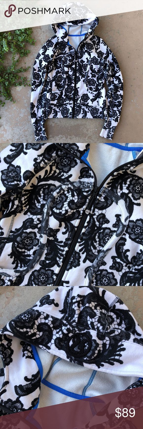 """Lululemon Laceoflage Floral Scuba Hoodie Jacket Black and white floral """"Laceoflage"""" Scuba zip up hoodie by Lululemon. Features front pockets, thumb holes, and an embroidered logo on the hood. The rip tag is removed, but it is a size 4 according to the size dot in the pocket. In great condition with no flaws. lululemon athletica Tops Sweatshirts & Hoodies"""