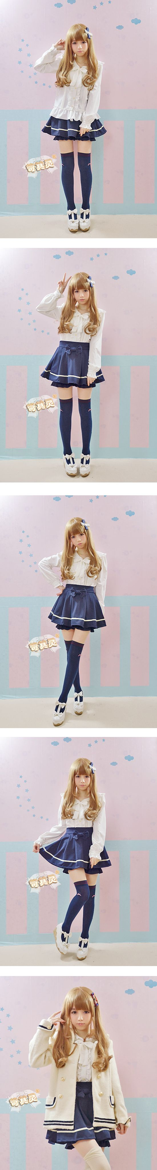Cute, sweet gyaru: Off white blouse with frills. Navy skirt with white details. Navy, thigh-high socks. Off white shoes with a bow.
