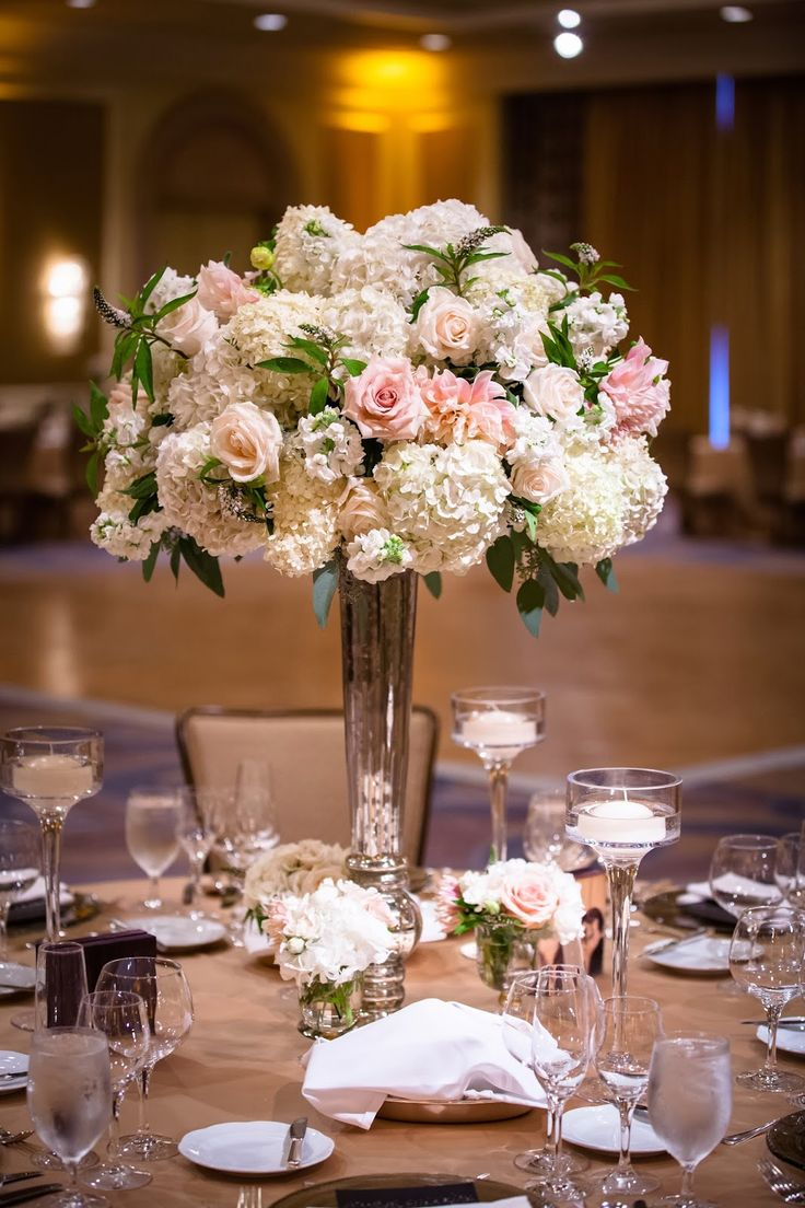 Some of the centerpieces will be tall silver vases filled