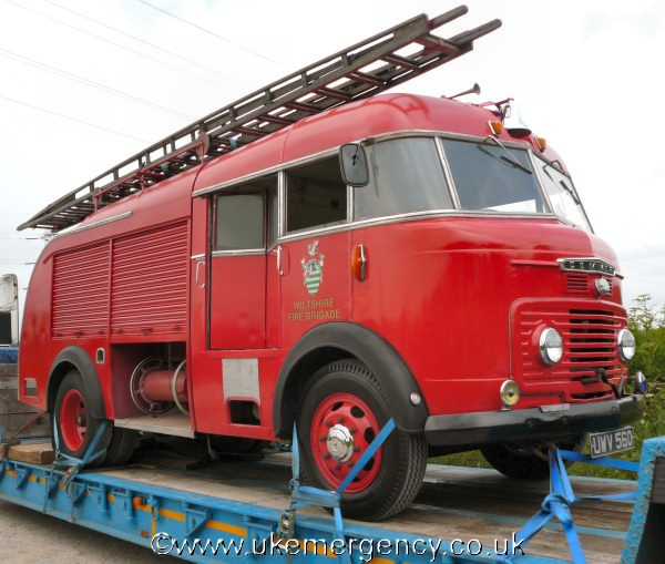 his is a preserved Commer Mark IV with Miles coachwork and was with Wiltshire Fire Brigade. Restoration began in 2005 when the vehicle was in a very poor condition with the engine not working. Notice the folding door to access the rear portion of the cab and the wooden ladders. Emergency warning equipment comes from a blue beacon, bell and horns mounted on the roof and a half blue static light on the nearside bumper