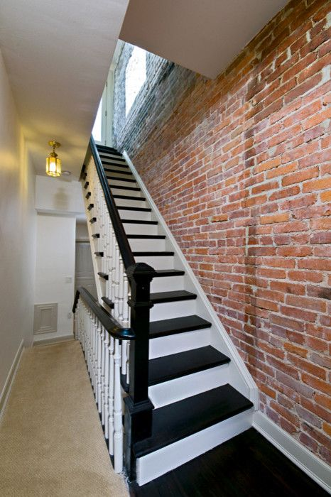 Exposed brick loft staircase traditional with black stairs painted brick