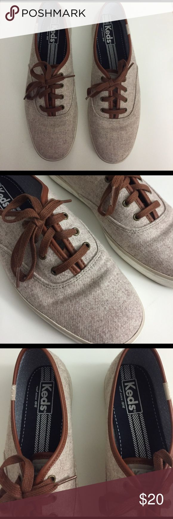 Keds classic sneakers These are the classic style of Keds sneakers. Color is a heathered tan with brown leather trim and laces. They also come with tan replacement laces. I only wore these out once so they are practically new! Keds Shoes Sneakers