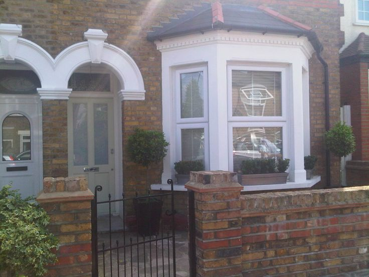 En2 Victorian house modernised .. Window boxes and topiary trees door colour
