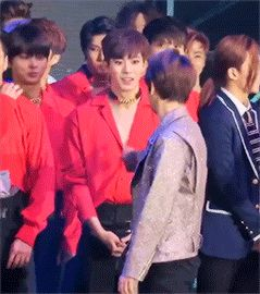 baekhyun running his finger down hongbin's chest because of his revealing outfit