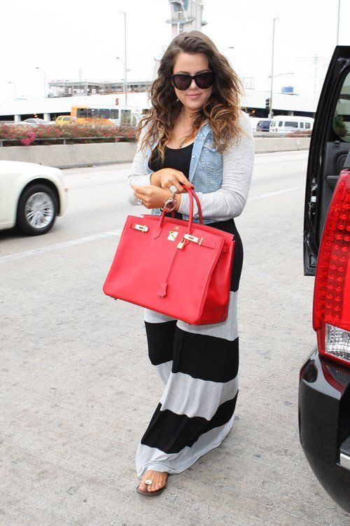 Khloe Kardashian Wears Jet Sweatshirt Denim Jacket, K-Dash Dress, Chanel Sandals and Carries Hermes Bag