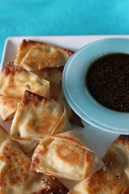 Baked Sriracha Cream Cheese Wontons with a spicy soy sauce