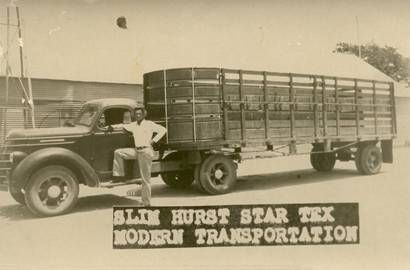 """Slim"" Hurst poses with his state-of-the-art cattle trailer. Star, Texas"