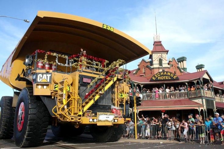 The Christmas fairy arrives on a 300-tonne mine truck during the St Barbara's parade in Kalgoorlie-Boulder, Western Australia, on December 5, 2012.