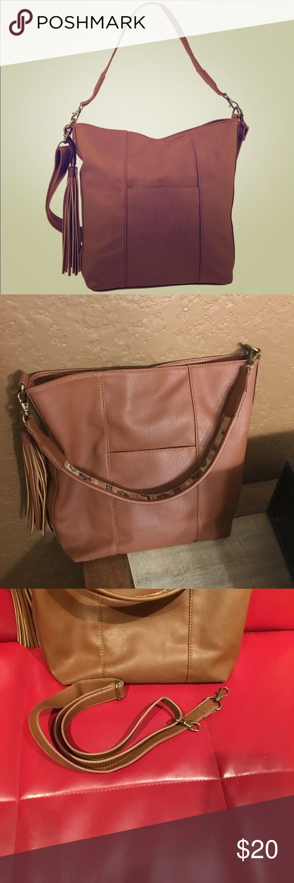 """Carlos Santana bucket tour bag Used very briefly, in excellent condition.  Vegan leather. Color is whiskey.  Comes with 2 straps.  Removable tassel detail.  Inside has zip pocket in one side me 2 slip pockets in other side.  Measures 15"""" x 11.5"""" x 5"""". Carlos Santana Bags Shoulder Bags"""