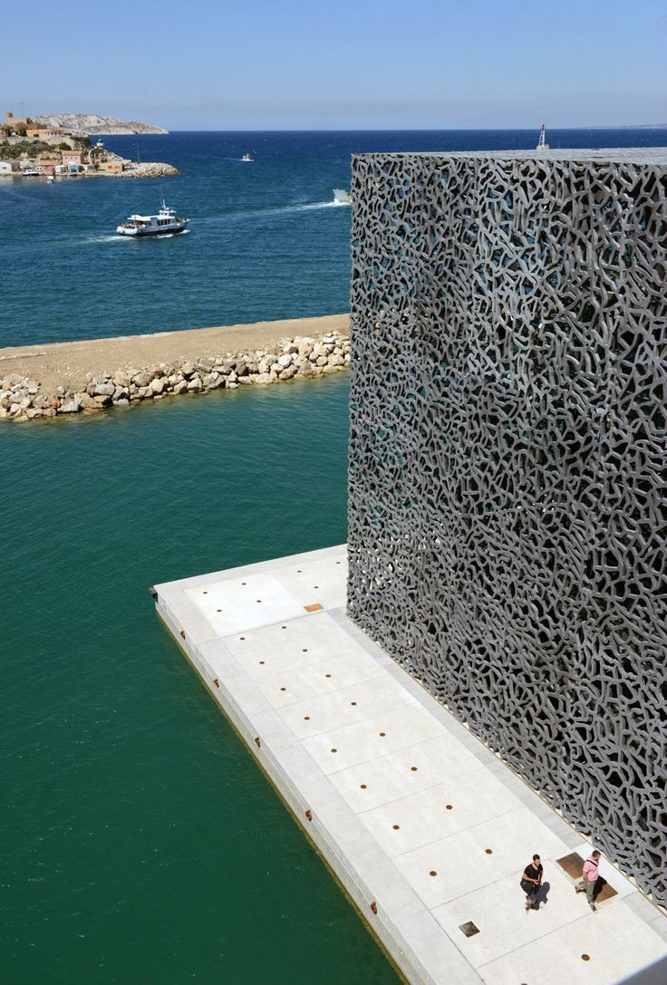 """The Museum of European and Mediterranean Civilisations (MuCEM) is a national museum located in Marseille, in the South of France. The museum built """"of stone, water and wind"""" was designed by the architect Rudy Ricciotti in collaboration with the architect Roland Carta. A cube of 15,000 square metres surrounded by a latticework shell of fibre-reinforced concrete."""