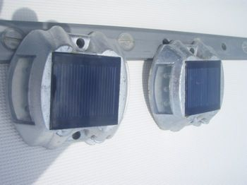 SolarWalk Lights. solar lights mounted on their stern boarding platform. Great for adding a bit of light for getting back aboard after sun setters