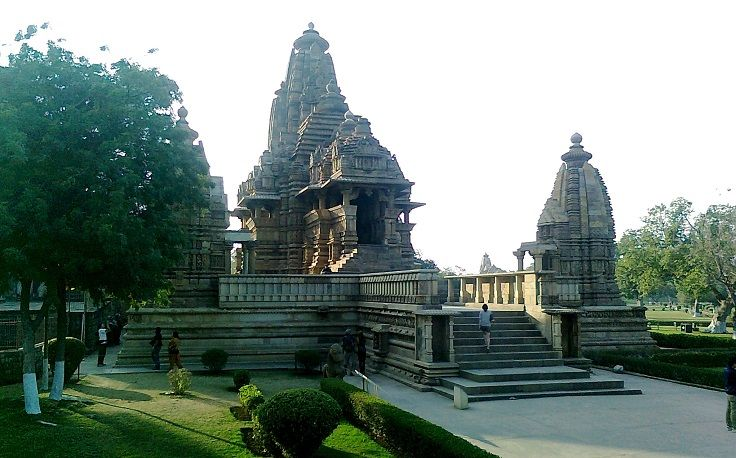 """Vishvanatha Khajuraho Temple is one of the finest Khajuraho Temple and is dedicated to Lord Shiva. The word Vishvanatha means """"Lord of the Universe"""". The wall contains carvings of couples making love and various mythical creatures."""