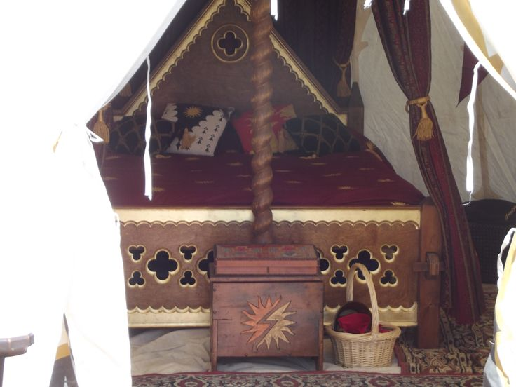 Now this is what I call camping!  This bed and trunk are in a tent at a SCA event.  Notice the joints on the corners - this bed comes apart for travel.  Beautiful details.  wish I could have gotten a closer look at it's construction.