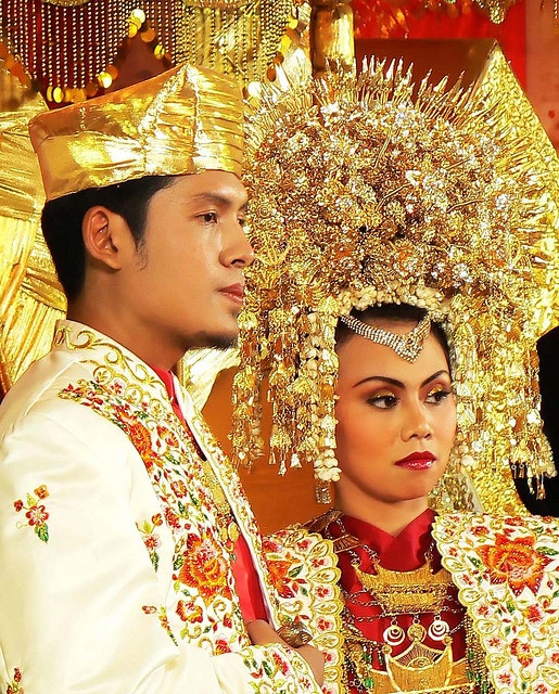 Indonesian marriage.  This special day is marked by numerous people, extravagant apparel, and many cultural aspects that are made evident throughout.  These unique ceremonies call onto the beings that cultures look so highly too for guidance and love throughout the couples lives.