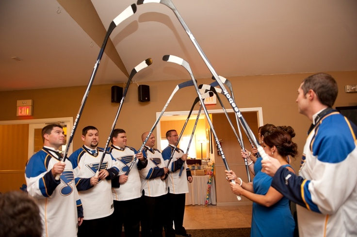 Walk in under an arch of hockey sticks  Photo by Arms Up Photography http://www.armsupphotography.com