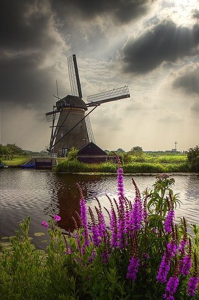 This is beautiful.  You can see the weather closing in behind the Windmill at Kinderdijk, Holland. By Dollia Sheombar.